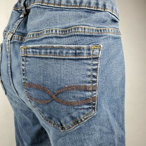 Torrid Relaxed Boot Cut Distressed Stretch Jeans